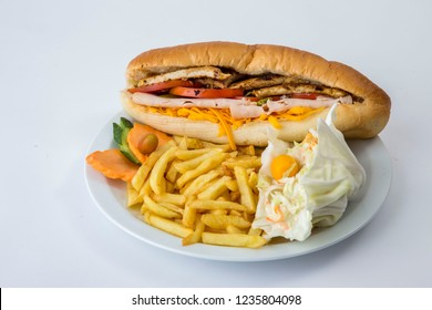 cordon bleu sandwich with cheese,  fries and coleslaw or Cole Slaw in white plate, on white background