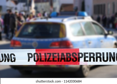"Cordon tape with the word ""Polizeiabsperrung"", the german word for police cordon"