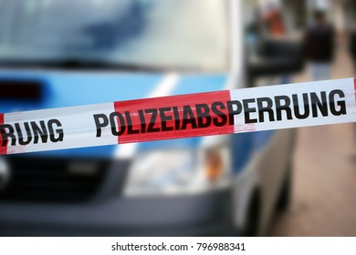 """Cordon tape with the word """"Polizeiabsperrung"""", the german word for police cordon"""