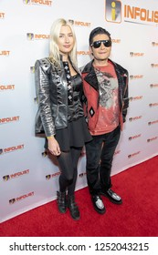 Corey Feldman, Courtney Anne Mitchell attends INFOList.com Red Carpet Re-Launch Party & Holiday Extravaganza! at SKYBAR at the Mondrian Hotel, Los Angeles, California on December 5th, 2018