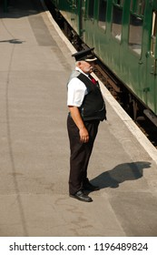 Corfe Castle, Dorset, UK - 3rd September 2018. Train guard or Station Master in period uniform on the station platform. Part of the Swanage steam railway.