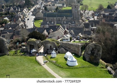 CORFE CASTLE, UK - 1st JUNE, 2012: Village of Corfe and ruins of Corfe Castle, in Swanage, Dorset, Southern England