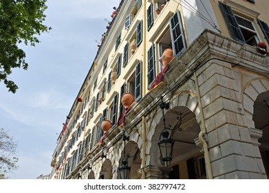 CORFU, GREECE - APRIL 18, 2009: At 11:00am on Holy Saturday, as is customary, Corfians throw jugs from balconies at the Liston Spaniada promenade on Holy Saturday, to celebrate the Resurrection.