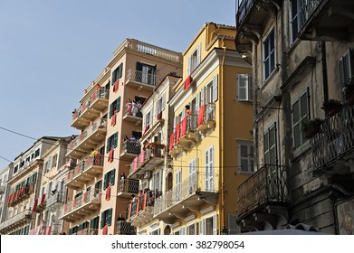 CORFU, GREECE - APRIL 18, 2009: Buildings dressed with red banners in anticipation of the Resurrection, as viewed from the crowded Kapodistriou street, on the morning of Holy Saturday.