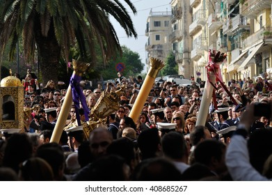 CORFU, GREECE - APRIL 18, 2009: Sailors and priests carrying the Epitaph during the customary lament procession through a crowd on the morning of Holy Saturday.
