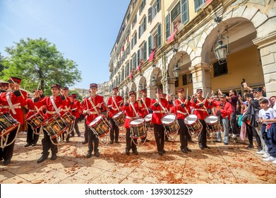 Corfu, Greece - April 27, 2019: Philharmonic musicians in the customary lament procession on the morning of Holy Saturday, at the old town of Corfu.