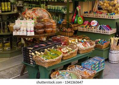 CORFU, GREECE - APRIL 7, 2018: A store that sales traditional for Corfu Island kumquat liqueur and kumquat fruits. Products from Corfu, Greece.