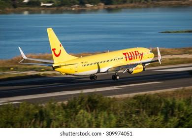 Corfu, Greece - August 18, 2015: TUIfly Boeing 737-800 landing on runway of Corfu International Airport.