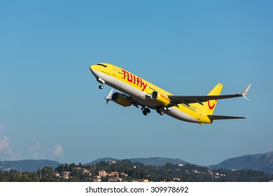 Corfu, Greece - August 18, 2015: TUIfly Boeing 737-800 taking off from Corfu International Airport.