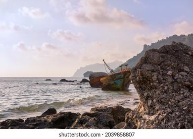 Corfu, Greece - August 18th 2020 - A ship wreck on the shore in Agios Gordios, Corfu island