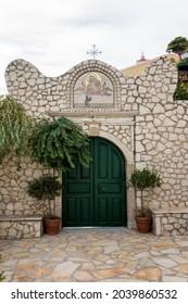 Corfu, Greece - August 18th 2020 - The gate to the monastery of Panagia Mirtidion, Myrtiotissa bay, Corfu, Greece
