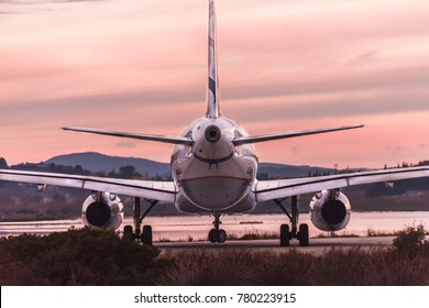 Corfu, Greece- December 21 ,2017 : An Airbus A320 of the Aegean Airlines a Greek company that has merged with Olympic Air,is taxiing at Corfu International Airport,against the sunrise.