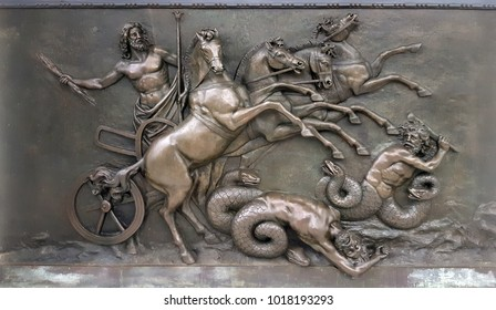 CORFU, GREECE- January 21, 2018: Metallic Panel depicting with Zeus, greek ancient god, in war chariots during battle against evil creatures at Achilleion palace, on Corfu island, Greece