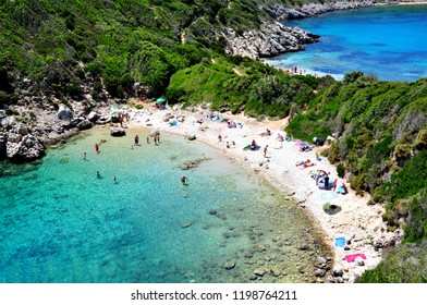 Corfu, Greece - July 16, 2018: Porto-timoni double beach close-up with people