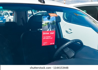 """Corfu, Greece - July, 2018: """"Drive me"""" sign on Avis rental car, which means that car is ready for driving ."""