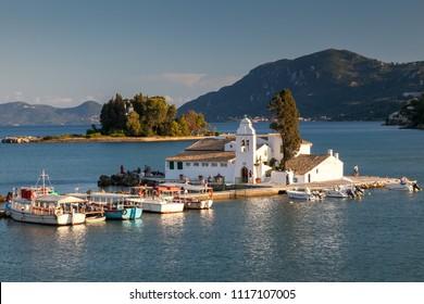 CORFU, GREECE - JULY 26, 2011: Vlacherna monastery and Pontikonisi island at sunset, Kanoni, Corfu island, Greece