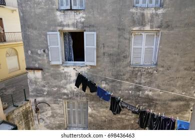 Corfu, Greece - JULY 30, 2017: Clothes Drying in the Wondow in Kerkyra Old Town Corfu