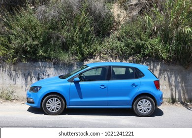 CORFU, GREECE - JUNE 2, 2016: VW Polo blue hatchback car parked in Corfu Island, Greece. With 566 registered vehicles per 1000 inhabitants Greece is below EU average (573).