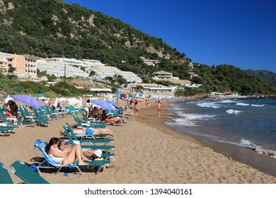 CORFU, GREECE - JUNE 3, 2016: Tourists enjoy Kontogialos beach in Pelekas, Corfu Island, Greece. 558,000 tourists visited Corfu in 2012.