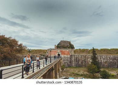 CORFU GREECE - OCTOBER 23 2018: Tourists at the entrance of the old Venetian fortress. Fortress is an interesting touristic and historical place