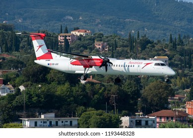 "CORFU / GREECE - SEPTEMBER 2018 Austrian Airlines De Havilland Canada DHC-8-402Q, OE-LGC, cn 4026, named ""Land Salzburg"" on the scenic final approach to runway 35."