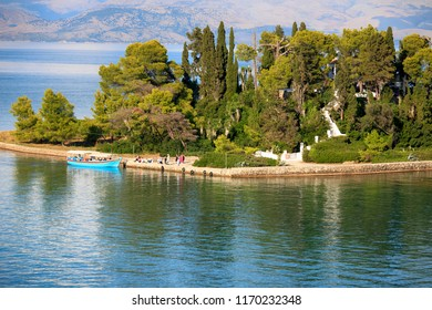 Corfu, Greece, September 3, 2014. Beautiful view of Mouse Island, where people and boat at the pier
