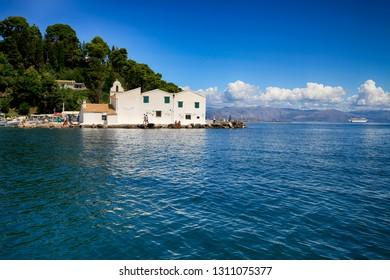 Corfu, Greece, September 3, 2014. View from the sea at the church Panagia Vlacherna near Kanoni