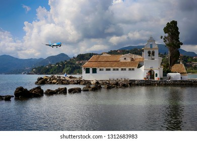 Corfu, Greece, September 3, 2014. Beautiful view at the church Panagia Vlacherna near Kanoni and passenger airliner in the sky