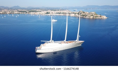 Corfu, Ionian / Greece - August 20 2018: Aerial drone photo of World's Largest Sailing Yacht named A, belonging to the Russian Billionaire Andrey Melnichenko anchored near port of Corfu
