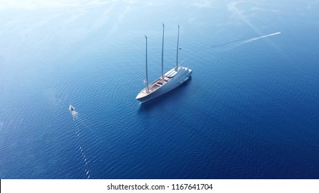 Corfu, Ionian / Greece - August 21 2018: Aerial drone photo of World's Largest Sailing Yacht named A, belonging to the Russian Billionaire Andrey Melnichenko anchored near port of Corfu
