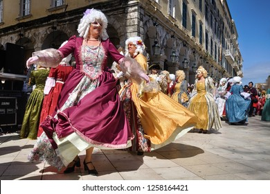 Corfu Island, Greece, 3/10/2013 Celebration of Carnival with a Parade at Old Corfu Town. Dancers wearing Traditional Venetian Costumes and Masks (Corfu Island was a Venetian Colony for many years)