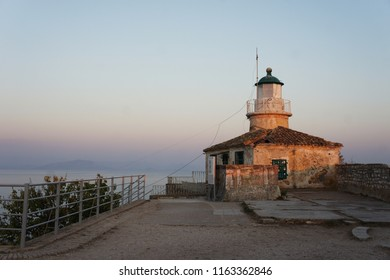 Corfu lighthouse in haze of the sunset light. Pastel colors