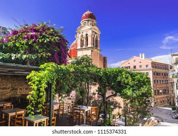 Corfu town picturesque street with cafe and flowers, Corfu island, Ionian islands, Greece