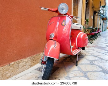 CORFU-AUGUST 22: Classic Vespa scooter on Kerkyra street on August 22, 2014 on Corfu island. Greece. Vespa is an Italian brand of scooter manufactured by Piaggio.