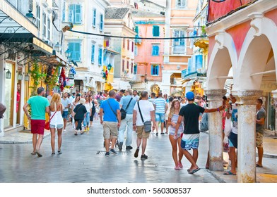 CORFU-AUGUST 22: Kerkyra old town with the row of souvenirs shops, locals and tourists go shopping on August 22, 2014 on Corfu island, Greece.