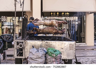 Corfu,Greece,September 16, 2017, Whole Lambs being barbecued on the street in Corfu Town in the Traditional way. It looks horrific but the smell is appetizing.