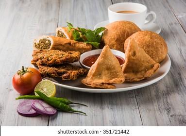 Coriander / Kothimbir vada, Samosa, Kachori, Daal Vada are favourite Indian tea time snacks. selective focus