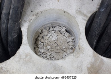 coring hole wire and hole, coring building site under construction,  wire transfer electric to room control, on the floor there is a hole and wire, selective focus.