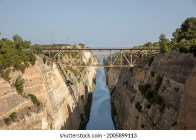 The Corinth Canal is a lockless shipping channel in Greece, connecting the Saronikos Gulf of the Aegean and the Corinthian Gulf of the Ionian Sea.