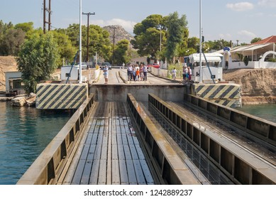 Corinth/ Greece- September 20, 2018 A submersible bridge at the entrance to the Corinth Canal is seen by a group of people as it rises.