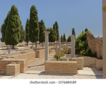Corinthian roman columns in the archeological excavation of the ruins of the Roman city of Italica, Santiponce, Sevilla, Andalusia, Spain