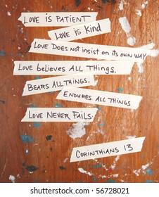 Corinthians 13 written on masking tape stuck to an old board