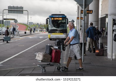 Cork Airport ,Ireland - September 25, 2019: Passengers  coming out of the arrivals terminal doors in Cork airport.