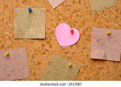 Cork board with heart shape sticky note