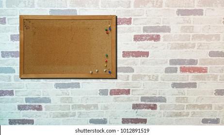 cork board on pastel brick wall