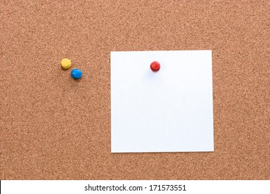 Cork board with a piece of paper