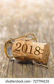 cork of champagne with new year's date 2018