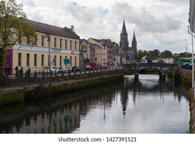 Cork City, Ireland - 18th June, 2019: Cork city centre, Saint Fin Barre's Cathedral in the distance.
