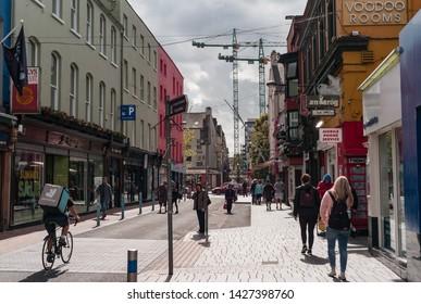 Cork City, Ireland - 18th June, 2019: Oliver Plunkett Street in Cork city centre,  Oliver Plunkett Street is a well known shopping street in Cork city, Ireland