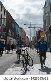 Cork City, Ireland - 18th June, 2019: Street scene on Oliver Plunkett Street in Cork city centre,  Oliver Plunkett Street is a well known shopping street in Cork city, Ireland
